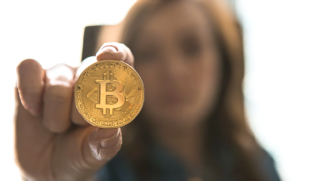 Woman with Bitcoin coin